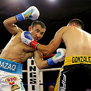 """Kanat """"QazaQ"""" Islam of Almaty, Kazakhstan (L) beats  Noroberto """"Demonio"""" Gonzalez of Monterrey, Mexico to win the NABO Jr. Middle Weight Title during a Nelsons Promotions boxing match at the Boca Raton Resort  and Club on Friday, May 26, 2017 in Boca Raton, Florida.  (Alex Menendez via AP)"""