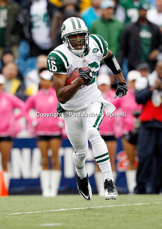 New York Jets kick returner Brad Smith (16) returns a kick during a NFL week 4 football game against the Buffalo Bills on Sunday, October 3, 2010 in Orchard Park, New York. The Jets won the game 38-14. (©Paul Anthony Spinelli)
