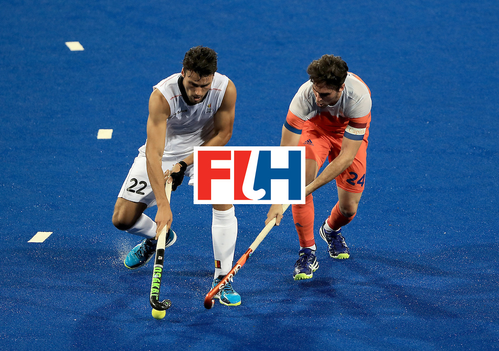 RIO DE JANEIRO, BRAZIL - AUGUST 16:  Simon Gougnard #22 of Belgium and Robert Van der Horst #24 of the Netherlands battle for a loose ball during a semifinal match on Day 11 of the Rio 2016 Olympic Games at the Olympic Hockey Centre on August 16, 2016 in Rio de Janeiro, Brazil.  (Photo by Sam Greenwood/Getty Images)