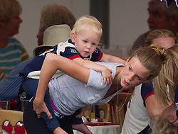 Image ©Licensed to i-Images Picture Agency. 02/08/2014. , United Kingdom.the Queens great grand daughter Isla Phillips gets a piggy back from her nanny  at theFestival of British Eventing. Gatcombe. Picture by i-Images