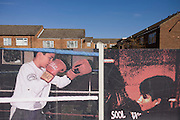 Fading aspirational poster showing local kids enjoying sports in housing estate opposite 2012 Olympic site, Stratford