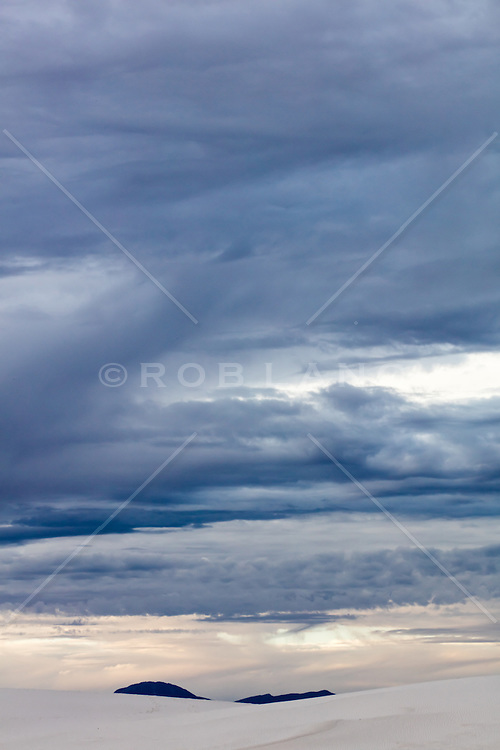 dark clouds over White Sands National Park in New Mexico
