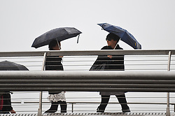 © Licensed to London News Pictures. 29/08/2012. London,UK. People with umbrellas walk along Millenium Bridge. Rain in Central London today 29th August 2012 .Photo credit : Thomas Campean/LNP.