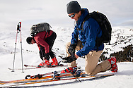 Skiers, Celin Serbo and DJ Nechrony, prepare themselves to ski the  backcountry bowls at Loveland Pass, Colorado.