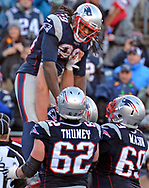 (Foxboro, MA 122416) Patriots LeGarrette Blount is hoisted up by his team mates after scoringing a touchdown. Staff photo Chris Christo