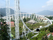 Top Roller Coaster's Of The World<br /> <br /> Dodonpa messes with your mind from the moment it starts, as passengers are forced to wait anxiously in a darkened tunnel before the countdown to an insanely fast acceleration out of the tunnel, screaming down the track and then getting fired up and over two humps which have 90 degree drops on each side. When the Dodonpa was opened in 2001, it was the fastest roller coaster in the world. As of 2010, it is not the fastest but still has the highest launch acceleration at 2.7 g. It is 52 meters (170 feet) tall, and has a launch speed of 172 km/h (107 mph), which is reached in less than 2 seconds. Located at Fuji-Q Highland, Fujiyoshida, Yamanashi, Japan, its hill goes straight up, down a hairpin curve, and then goes straight down. <br /> (©Exclusivepix)