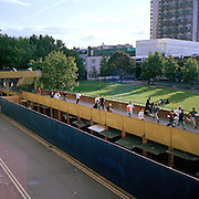 teenage gang of boys and girls run across walkway on the Heygate estate in south London after being approached by undercover police.