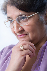 Portrait of an older woman looking thoughtful,