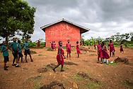 Children play outside at Saint Theresa Primary Girls School in Mattru Jong, Sierra Leone. (photo by Sarah Baker)