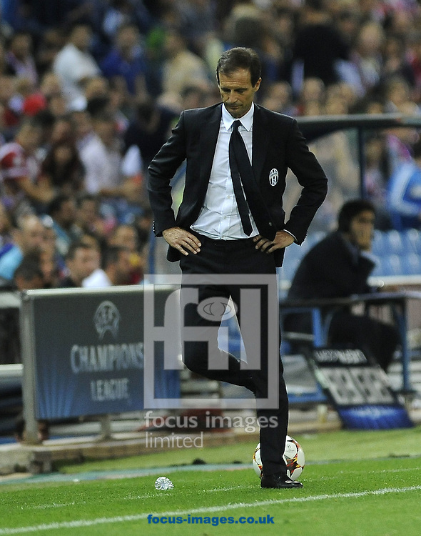 Massimiliano Allegri, head coach of Juventus during the UEFA Champions League match at Vicente Calder&oacute;n Stadium, Madrid<br /> Picture by Stefano Gnech/Focus Images Ltd +39 333 1641678<br /> 01/10/2014