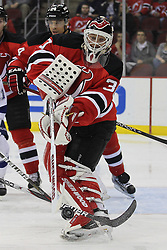 Mar 29; Newark, NJ, USA; New Jersey Devils goalie Martin Brodeur (30) plays the puck during the second period of their game against the Tampa Bay Lightning at the Prudential Center.