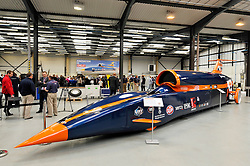 © Licensed to London News Pictures. 04/07/2013. Bristol, UK.  A 13m long full sized replica at the Bloodhound Supersonic Car project official opening of the new technical centre in Avonmouth, Bristol.  The car is being built to go at 1000mph to break the land speed record, powered by a rocket and a Rolls Royce EJ200 jet engine with a Cosworth engine being used as a pump.  The record attempt will take place in South Africa and Bloodhound will be piloted by Wing Commander Andy Green from the RAF.  David Willetts, Minister for Science and Universities, took part in joining parts of the bodywork together.  04 July 2013.<br /> Photo credit : Simon Chapman/LNP