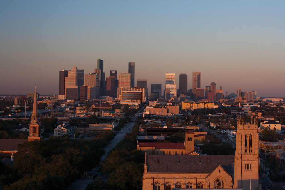 Houston, Texas skyline with cathedral in foreground at dusk.