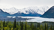 Matanuska Glacier, source of the Matanuska River in Alaska, is the largest glacier accessible by car in the United States: 27 miles (43 km) long by 4 miles (6.4 km) wide. It flows near the Glenn Highway in the Chugach Mountains about 100 miles (160 km) northeast of Anchorage. Matanuska Glacier flows about 1 foot (30 cm) per day. Due to ablation of the lower glacier, as of 2007, the location of the glacier terminus has changed little over the previous three decades. Panorama stitched from 2 overlapping photos.