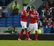 Charlton Athletic striker Reza Ghoochannejhad (16) scores a second for Charlton during the Sky Bet Championship match between Brighton and Hove Albion and Charlton Athletic at the American Express Community Stadium, Brighton and Hove, England on 5 December 2015.