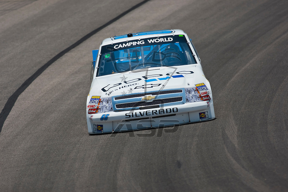 Fort Worth, TX - June 09, 2011:  Justin Marks brings his Camping World Truck Series truck through the turns during a practice session for the WinStar World Casino 400 race in Fort Worth, TX.