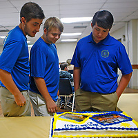 PETRE THOMAS | BUY  AT PHOTO.DJOURNAL.COM James Ingram, Greg Hollingsworth, and Palmer Earnest look at a cake with with pictures of the team with the solar car in Australia.