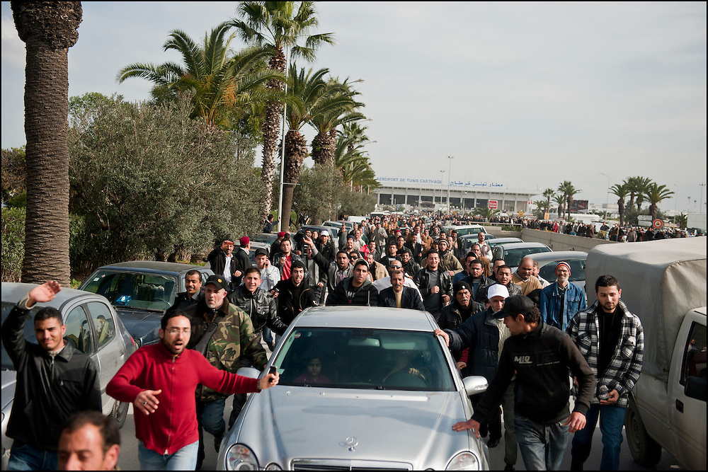 The Islamist opponent Rached Ghannouchi arrived on sunday in Tunis after more than 20 years of exil, thousands of tunisians welcome him at Carthage International Airport on January 30, 2011. Copyright Benjamin Girette