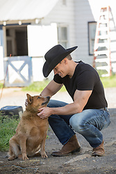 cowboy with a dog on a ranch