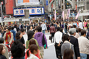 people crossing the Hachiko intersection at Shibuya station