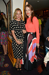 Left to right, CHARLOTTE DELLAL and ROKSANDA ILINCIC at an exclusive dinner for Iris Apfel held at Annabel's, Berkeley Square, London on 29th July 2015.