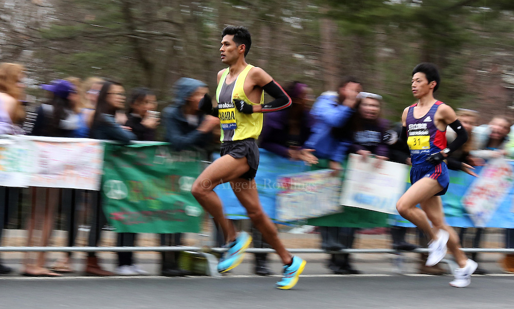 (Wellesley, MA - 4/20/15) Fernando Cabada, left, of Fresno, races past Wellesley College with Yosuke Chida (31) of Japan at his back during the Boston Marathon, Monday, April 20, 2015. Staff photo by Angela Rowlings.
