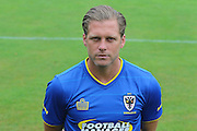 AFC Wimbledon midfielder Dannie Bulman at AFC Wimbledon Team Photo 02AUG16 at the Cherry Red Records Stadium, Kingston, England on 2 August 2016. Photo by Stuart Butcher.