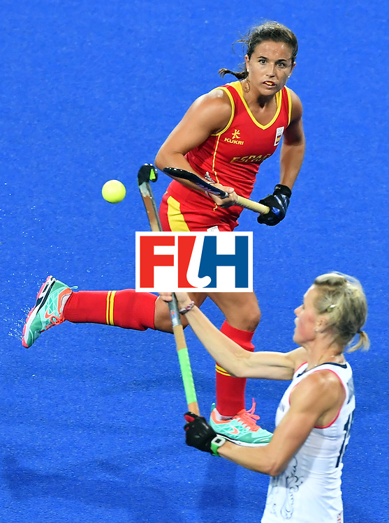Spain's Rocio Gutierrez (top) vies with Britain's Alex Danson during the women's quarterfinal field hockey Britain vs Spain match of the Rio 2016 Olympics Games at the Olympic Hockey Centre in Rio de Janeiro on August 15, 2016. / AFP / Pascal GUYOT        (Photo credit should read PASCAL GUYOT/AFP/Getty Images)