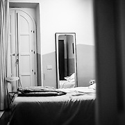 """Rome - near Termini Station. A view of the room of """"the english"""", as it was dubbed the American citizen, , inside his house at the time of the arrest. He arrived about a month ago from Chicago. The pedophile who lured underage kids to Termini Station. Egyptians, magrhrebini and even nomads and required them to paid sexual services."""