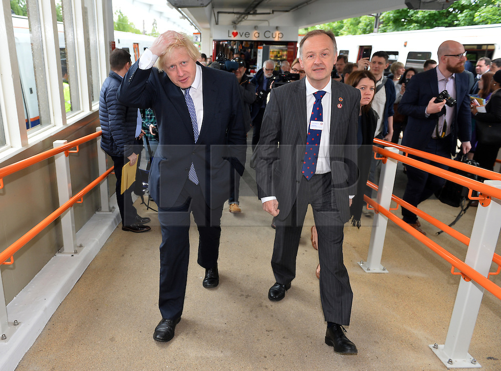 © Licensed to London News Pictures. 01/06/2015. <br /> LONDON, UK. Boris Johnson (L) welcomes expansion of TfL rail services. The Mayor of London visits Enfield Town station to meet staff ahead of TfL taking on responsibility of additional stations and a number of rail services out of Liverpool Street station, London, Monday 01 June 2015. Photo credit : Hannah McKay/LNP