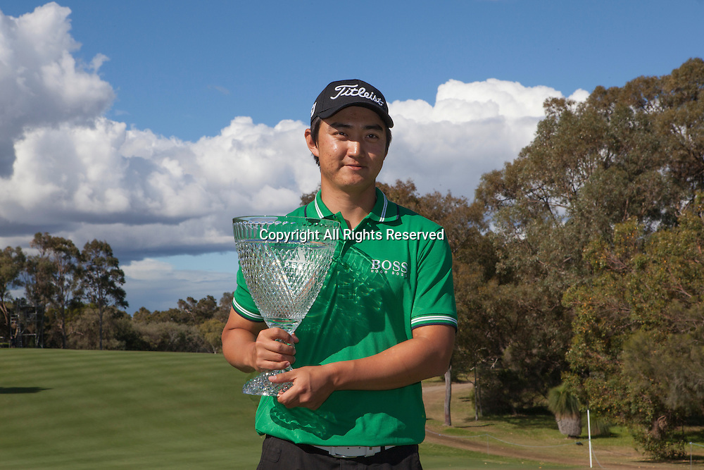 20.10.2013 Perth, Australia. Jin Jeong (KOR) poses with his trophy after beating Ross Fisher (ENG) in a play off during the final day of the ISPS Handa Perth International Golf Championship from the Lake Karrinyup Country Club.