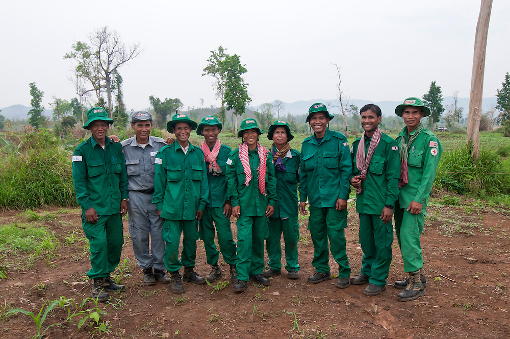 Group photo of Sokhon and other deminers from left to right:  Ngen Sarum (Amputee), Im Samkul (supervisor), Mey Thorn, Hean Sean, Kheun Sokhon (Amputee), Kong Tha, Cheap Yoeurn (Amputee), Sath Samon (Amputee), Sam Khan..