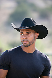 Portrait of a hot black cowboy outdoors