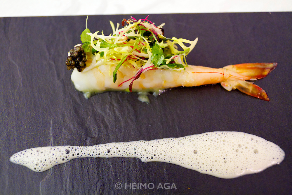 Singapore. Marina Bay Sands. Sky on 57 showcases a modern twist of Franco Asian Cuisine in a setting that offers a birds eye view of Singapore and the bay..Ocean King Prawn.Steamed with stuffed avocados, champagne emulsion, micro greens