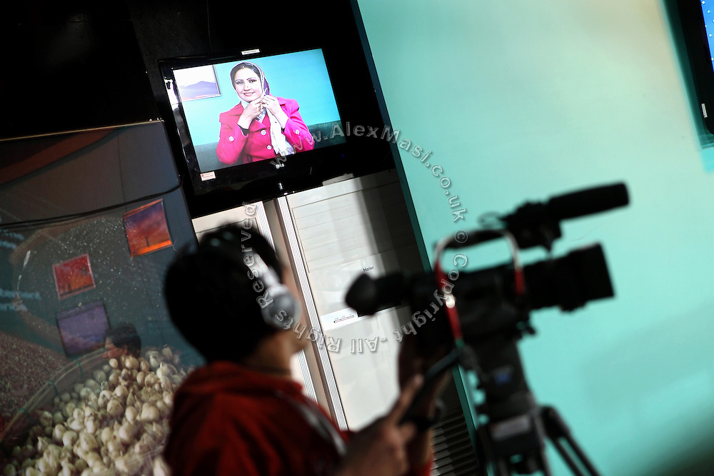 Azita Arif Nazimi, 25, is presenting 'Family Live Show', a television program broadcasted live by Channel 1, an Afghan national television, in Kabul, Afghanistan.