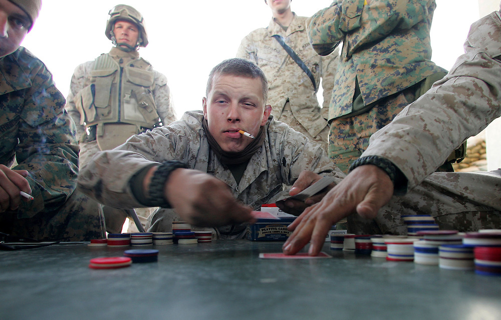 1 December 2004..South Central Iraq..US Marines in South Central Iraq...In an effort to crush the insurgent groups operating in North Babel province US Marines have set up Forward |Operating Bases in the heart of enemy territory...At 22 Alpha a small base on a central highway Marines pass the time not consumed by operations by playing poker. ...Hold for copy by John Burns slugged 'WAR'