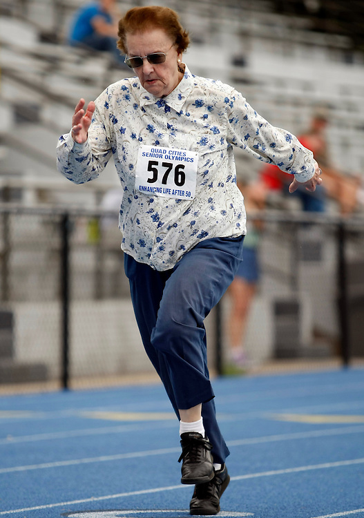 Doris Forbes, 80, of Beloit, Wisconsin competes in the 100-meter sprint during the 21st Annual Senior Olympics at the Paul V. Olsen Track at Augustana College in Rock Island, Illinois on Saturday, June 25, 2011.  Forbes qualified for 5 events in the National Senior Olympic Games..