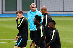Manchester City Manager, Manuel Pellegrini watches his players during the training session at the Etihad Stadium ahead of the UEFA Champions League group D match against Juventus - Mandatory byline: Matt McNulty/JMP - 07966386802 - 14/09/2015 - FOOTBALL - Etihad Stadium -Manchester,England - UEFA Champions League