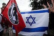 Frankfurt am Main | 04 Aug 2014<br /> <br /> Am Montag (04.08.2014) demonstrierten in Frankfurt am Main etwa 400 Menschen aus verschiedenen linken und linksradikalen Gruppen, aus der j&uuml;dischen Gemeinde und der Frankfurter Stadtgesellschaft gegen Antisemitismus und Judenhass. In den vergangenen Wochen war es in der Bankenstadt immer wieder zu antisemitischen Vorf&auml;llen wie Schmierereien an einer Synagoge, Hass-Kundgebungen oder einer eingeworfenen Scheibe bei einer j&uuml;dischen Familie und Beschimpfungen als &quot;Judenschweine&quot; gekommen.<br /> Hier: Die Fahne &quot;Antifaschistische Aktion&quot; und die Flagge von Israel vor der Paulskirche.<br /> <br /> &copy;peter-juelich.com<br /> <br /> [No Model Release | No Property Release]