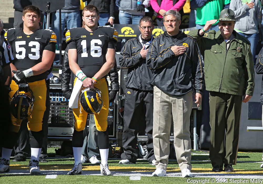 September 22 2012: Iowa Hawkeyes offensive linesman James Ferentz (53), quarterback James Vandenberg (16), and head coach Kirk Ferentz stand for the National Anthem before the start of the NCAA football game between the Central Michigan Chippewas and the Iowa Hawkeyes at Kinnick Stadium in Iowa City, Iowa on Saturday September 22, 2012. Central Michigan defeated Iowa 32-31.