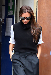 Fashion designer Victoria Beckham seen leaving her new London clothes store, that is due to open at the end of summer 2014. London. UK. 29/08/2014<br /> <br />BYLINE MUST READ : JAMESY/GOTCHA IMAGES<br /><br />Copyright by © Gotcha Images Ltd. All rights reserved.<br />Usage of this image is conditional upon the acceptance <br />of Gotcha Images Ltd, terms and conditions available at<br />www.gotchaimages.com