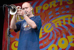Man playing a Flugelhorn on stage at  the Cropredy Festival  Fairport's Cropredy Convention  2005
