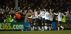 BLACKPOOL, ENGLAND - Tuesday, January 25, 2011: Manchester United's players celebrate Dimitar Berbatov's third and winning goal against Blackpool during the Premiership match at Bloomfield Road. (Photo by David Rawcliffe/Propaganda)