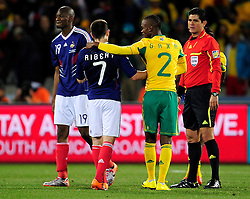 Franck Ribery exchanges handshakes with Gaxa of SA after the 2010 World Cup Soccer match between South Africa and France played at the Freestate Stadium in Bloemfontein South Africa on 22 June 2010.