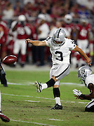 Oakland Raiders kicker Giorgio Tavecchio (3) kicks a first quarter extra point good for a 17-3 Raiders lead during the 2016 NFL preseason football game against the Arizona Cardinals on Friday, Aug. 12, 2016 in Glendale, Ariz. The Raiders won the game 31-10. (©Paul Anthony Spinelli)