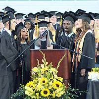 From left, Marco Garza, Talijah Jones, Leigh Kathryn Reynolds, Matthew Buckingham and Anna Trautman lead the singing of Amory High School's alma mater during Monday's graduation at Longenecker Field.