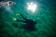 UC Davis researcher Brant Allen dives in Emerald Bay where divers are placing mats on the lake floor to control Asian clams, an invasive species to Lake Tahoe at Camp Richardson, Calif., October 30, 2012.