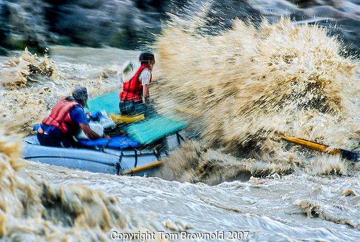 First time boatman getting a good look at the big wave in the middle of Waltenburg Rapid (river mile 112+/-).