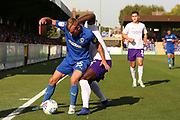 AFC Wimbledon attacker Marcus Forss (15) battles for possession with Shrewsbury Town defender Aaron Pierre (2) during the EFL Sky Bet League 1 match between AFC Wimbledon and Shrewsbury Town at the Cherry Red Records Stadium, Kingston, England on 14 September 2019.