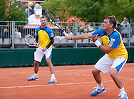(R) Marcin Matkowski & (L) Mariusz Fyrstenberg both from Poland compete at men's double game while Day Third during The French Open 2013 at Roland Garros Tennis Club in Paris, France...France, Paris, May 28, 2013..Picture also available in RAW (NEF) or TIFF format on special request...For editorial use only. Any commercial or promotional use requires permission...Mandatory credit:.Photo by © Adam Nurkiewicz / Mediasport